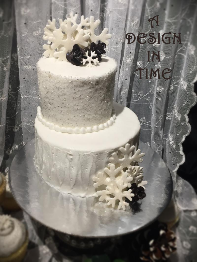A DESIGN IN TIME - SEASONAL OR THEMED WEDDING CAKES
